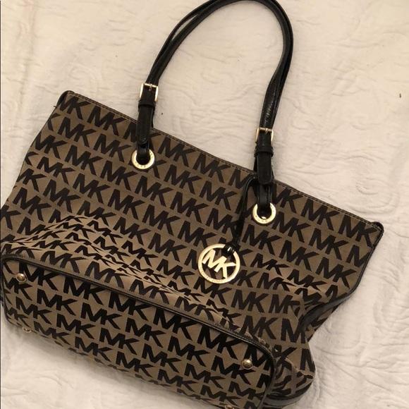 712e456bfc17 Black and Tan MK Michael Kors purse. M_5adf4b0872ea8871ed413f77